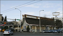 A boarded-up former Denny's restaurant in Seattle's Ballard neighborhood has been designated as a landmark because of its link to the Space Needle.