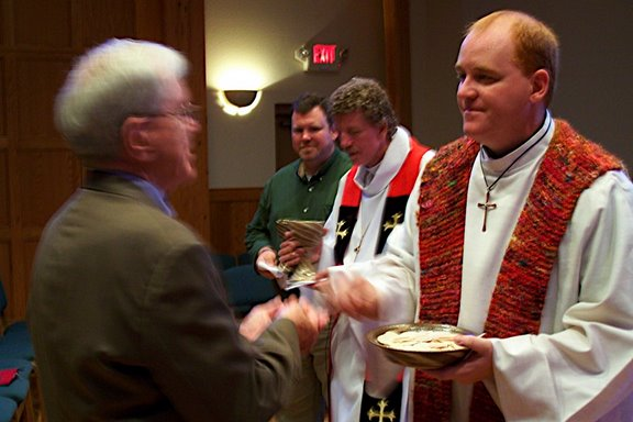 Serving Communion at my ordination service